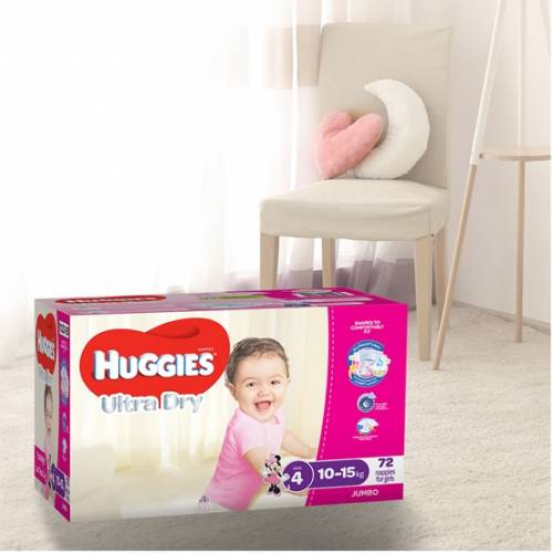 Huggies Ultra Dry Nappies in a nursery room with cream wooden chair at the corner