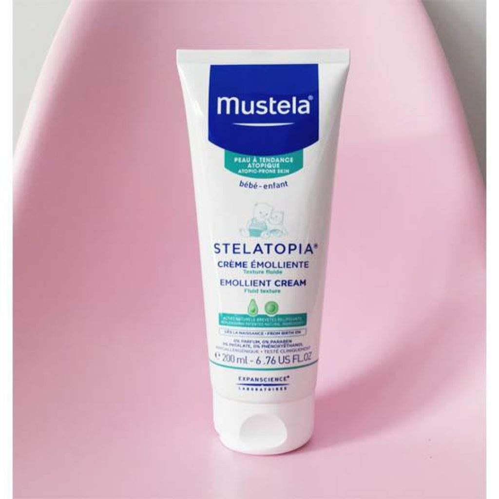 200mL tube pack of Mustela Stelatopia® Emollient Cream on a pink chair