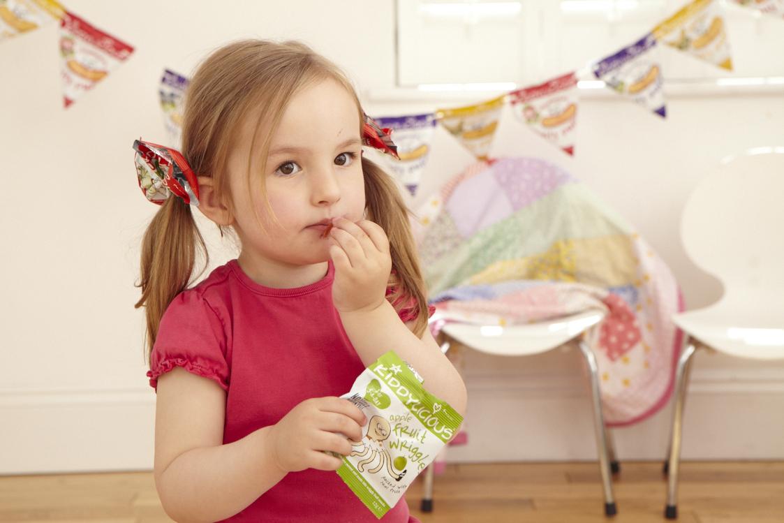 Little girl eating Kiddylicious snacks