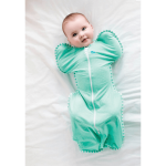 Baby Lying on Bed Wearing Mint Love To Dream Swaddle UP™ Lite 0.2 TOG