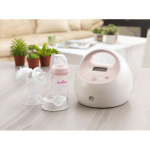 Spectra S2 Hospital Grade Double Electric Breast Pump with bottle sitting on the table