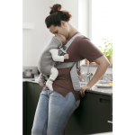 A mom carrying her newborn baby using a BabyBjorn Baby Carrier Mini Light Grey/3D Mesh Lifestyle