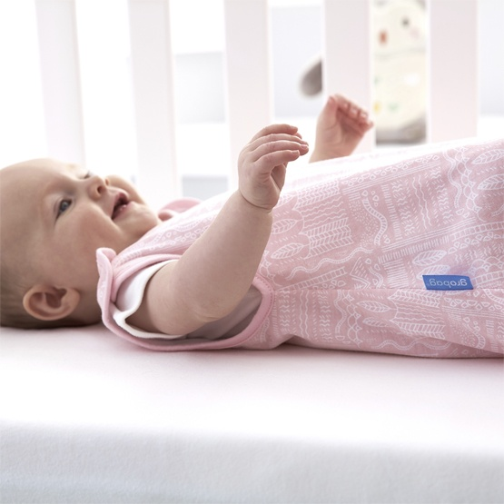 Baby Lying Inside a Cot Wearing a Pink Gro Company Scandi Harvest Grobag 1.0 Tog